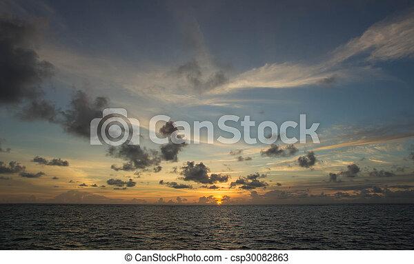 Beautiful sky over the ocean at sunset - csp30082863