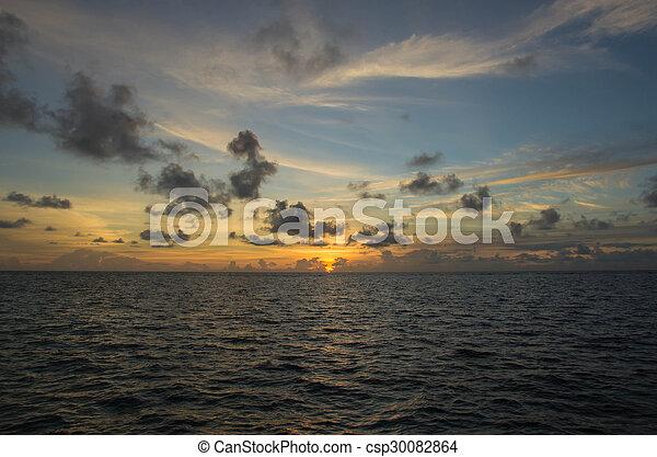 Beautiful sky over the ocean at sunset - csp30082864
