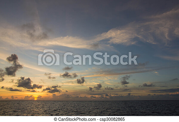 Beautiful sky over the ocean at sunset - csp30082865