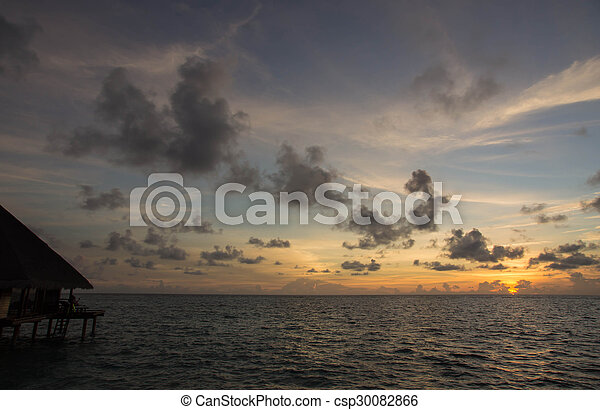 Beautiful sky over the ocean at sunset - csp30082866