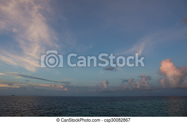 Beautiful sky over the ocean at sunset - csp30082867