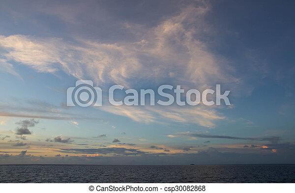 Beautiful sky over the ocean at sunset - csp30082868