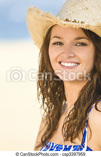 ee9a7d82c17a4 Beautiful smiling brunette girl in straw cowboy hat. A sexy and ...