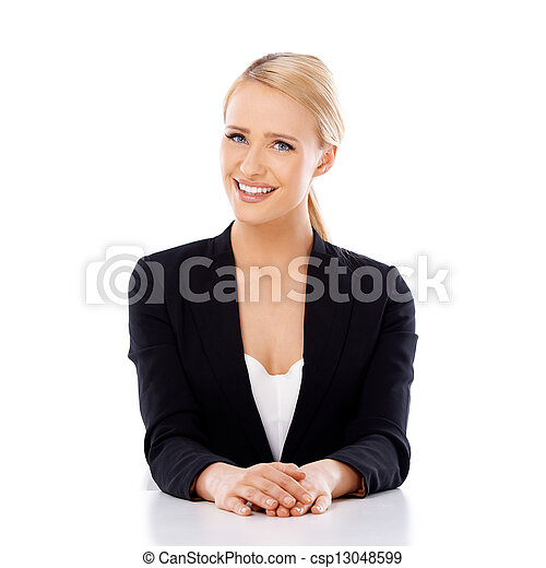 Beautiful smiling business woman sitting at the desk - csp13048599