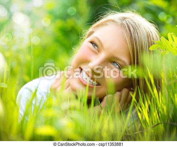 Beautiful Smiling Girl in Green Grass - csp11353881