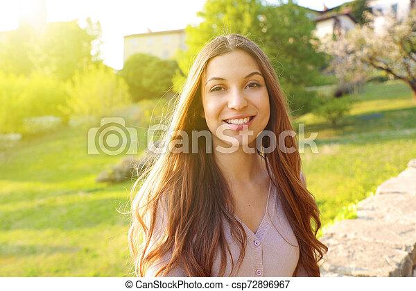 Beautiful smiling woman outdoor portrait - csp72896967
