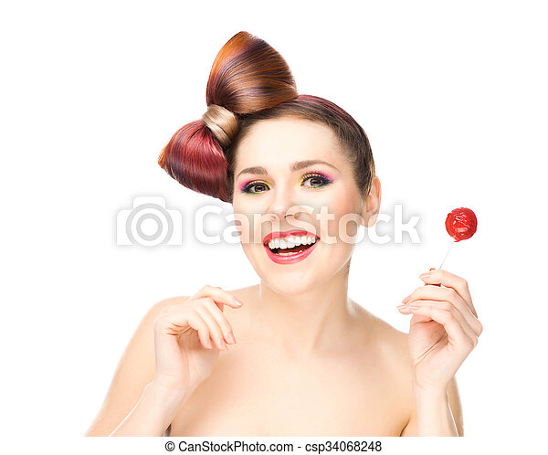 Beautiful smiling woman with a lollipop. - csp34068248