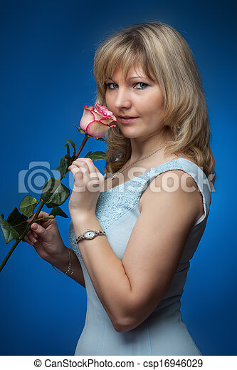 beautiful smiling woman with rose in a studio - csp16946029
