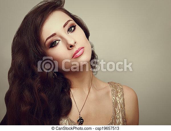 Beautiful smoky eyes makeup woman with long healthy brown hair. Closeup - csp19657513