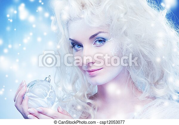 Beautiful snow queen with a christmas ball - csp12053077