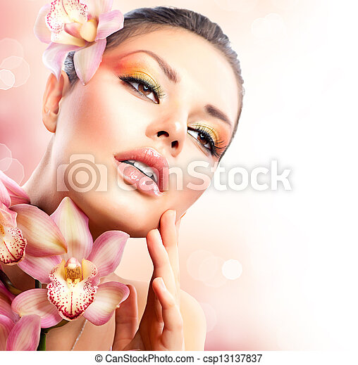 Beautiful Spa Girl With Orchid Flowers Touching her Face  - csp13137837