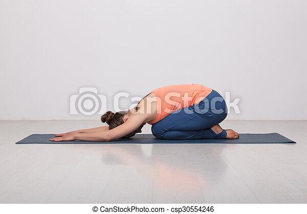 beautiful sporty fit yogi girl practices yoga asana