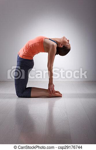 beautiful sporty fit yogini woman practices yoga asana