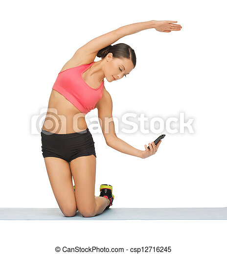 beautiful sporty woman doing exercise - csp12716245