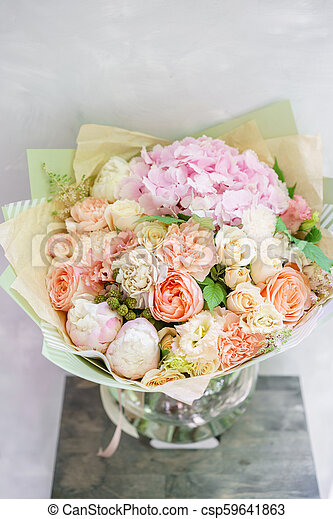 Beautiful spring bouquet flower arrangement with hydrangea and beautiful spring bouquet flower arrangement with hydrangea and peonies color light pink the concept of a flower shop a small family business mightylinksfo