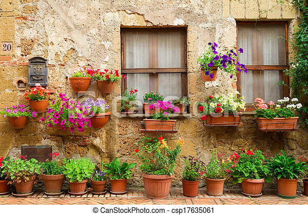 Beautiful street decorated with flowers in Italy - csp17635061