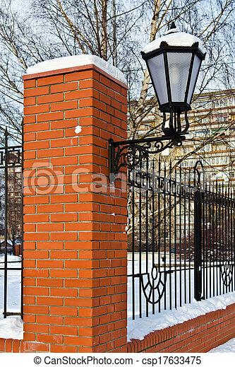 Beautiful street lamp at the red-brick wall - csp17633475