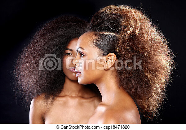 Beautiful Stunning Portrait of Two African American Black Women With Big Hair - csp18471820