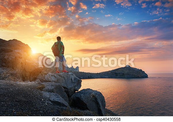 Beautiful summer landscape with standing man with backpack - csp40430558