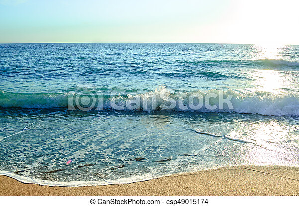 Beautiful Summer Seascape with Waves of Blue Sea and Sand Beach in Sun Light. Travel and Vacation Concept. - csp49015174