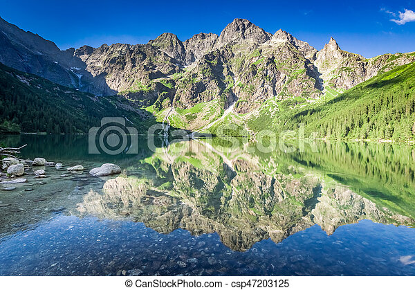 Beautiful sunrise at lake in the Tatra Mountains, Poland, Europe - csp47203125