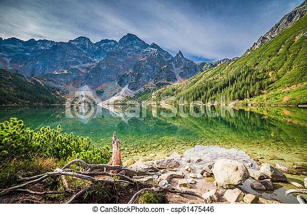 Beautiful sunrise at lake in the Tatra Mountains in autumn - csp61475446