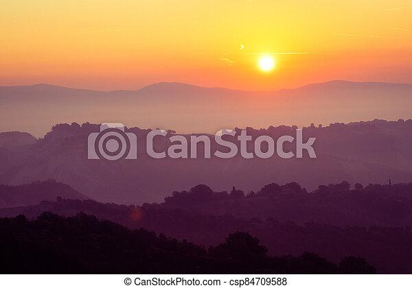 Beautiful sunrise at mountain landscape in summer. - csp84709588
