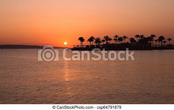Beautiful sunrise in Egypt on the beach. - csp64791879