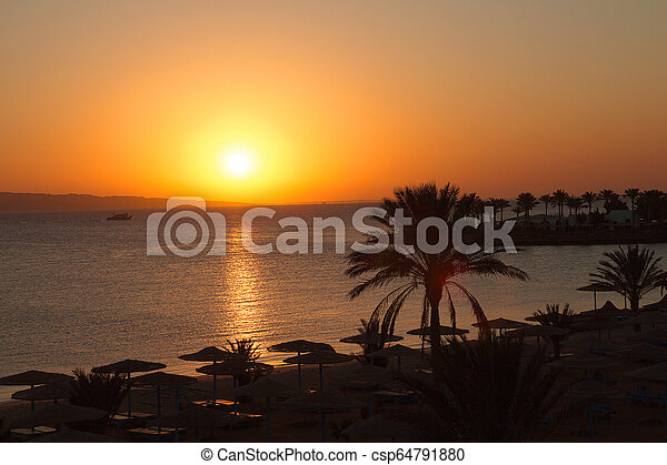 Beautiful sunrise in Egypt on the beach. - csp64791880
