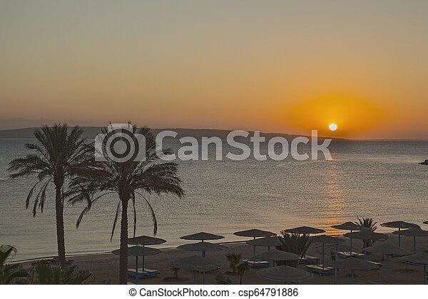 Beautiful sunrise in Egypt on the beach. - csp64791886