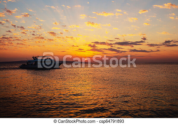 Beautiful sunrise in Egypt on the beach. - csp64791893