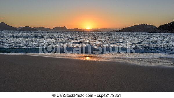 Beautiful Sunrise with the sun rising out of the ocean, Rio de Janeiro - csp42179351