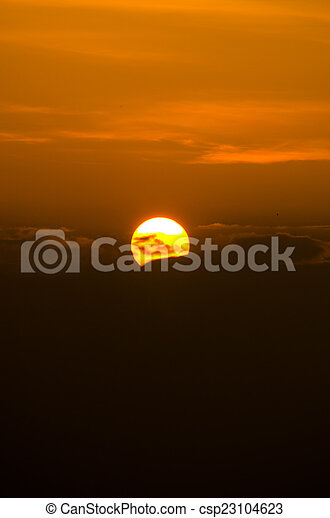 Beautiful sunset and sky over the mountain - csp23104623
