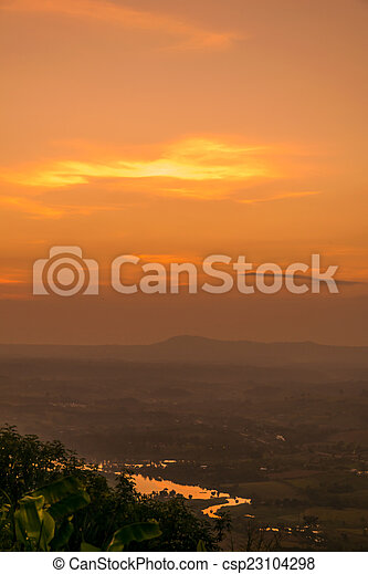 Beautiful sunset and sky over the mountain - csp23104298