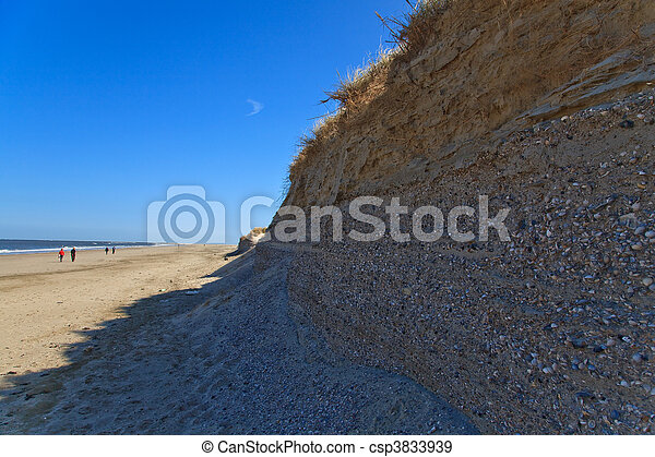 Beautiful sunset at the beach with sand dunes - csp3833939