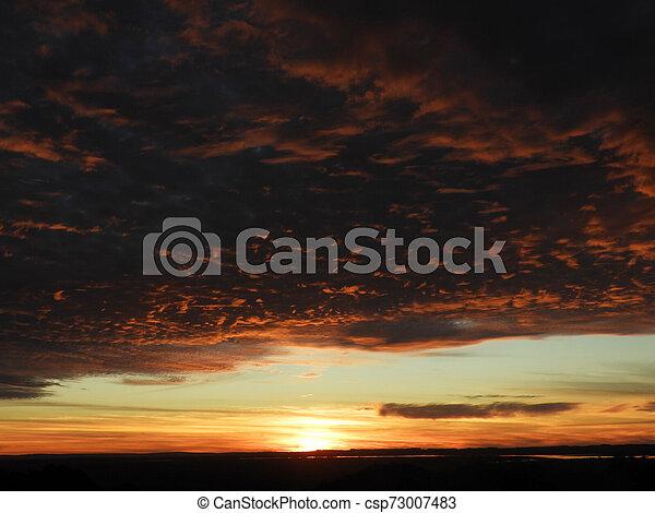 beautiful sunset illuminated with soft clouds - csp73007483