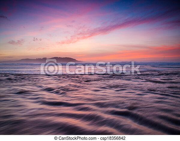 Beautiful sunset in the beach. - csp18356842