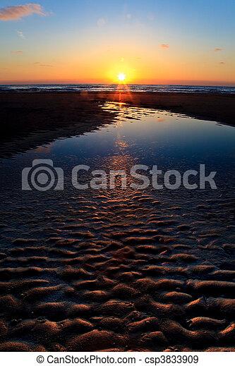Beautiful sunset in the ocean - csp3833909