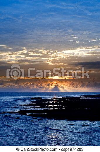 beautiful sunset in the ocean - csp1974283