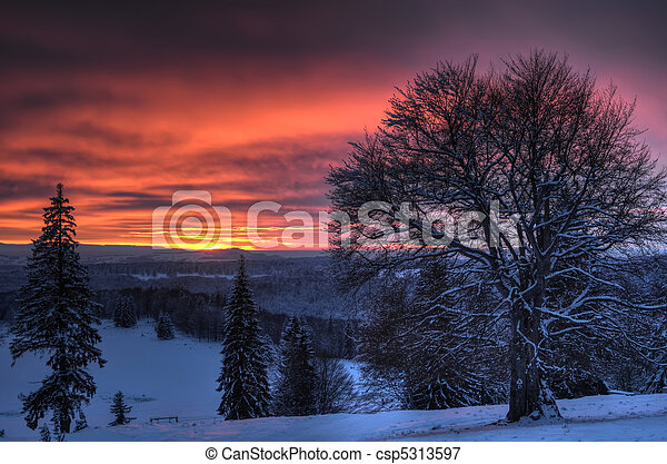 Beautiful sunset in winter mountain landscape - csp5313597