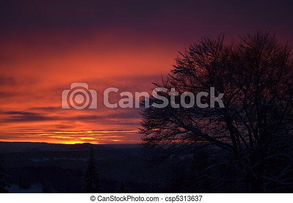 Beautiful sunset in winter mountain landscape - csp5313637