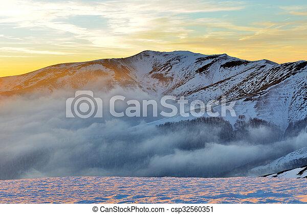 Beautiful sunset in winter mountain - csp32560351