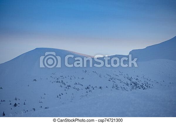 Beautiful Sunset in Winter Mountains. - csp74721300