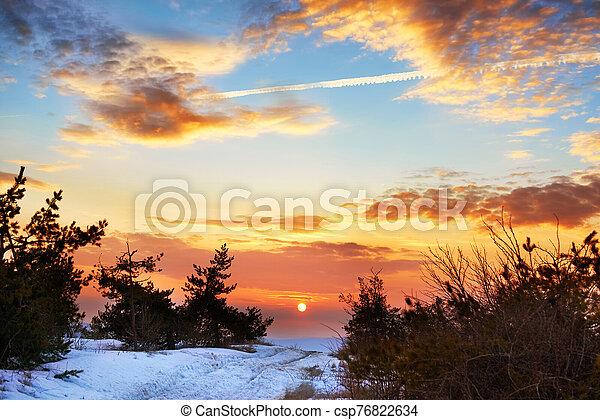 Beautiful sunset in winter mountains - csp76822634