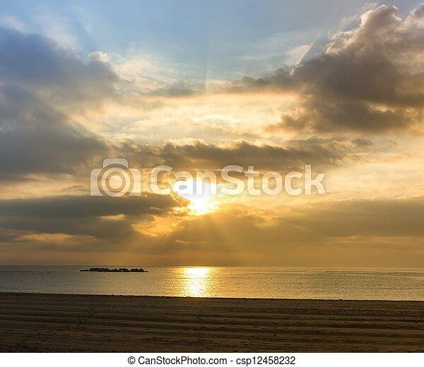 Beautiful sunset over a beach - csp12458232