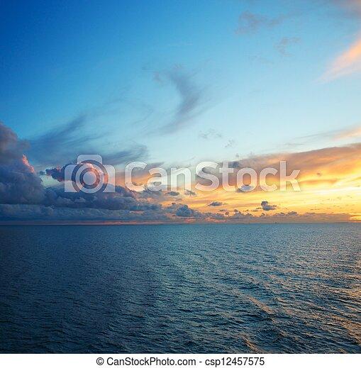 Beautiful sunset over an ocean - csp12457575