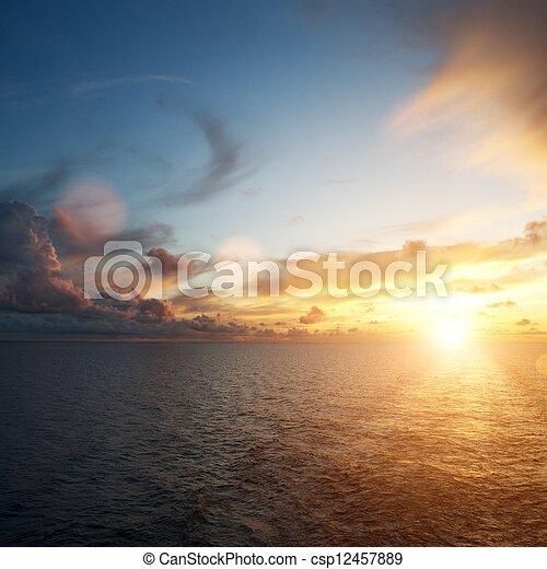 Beautiful sunset over an ocean - csp12457889