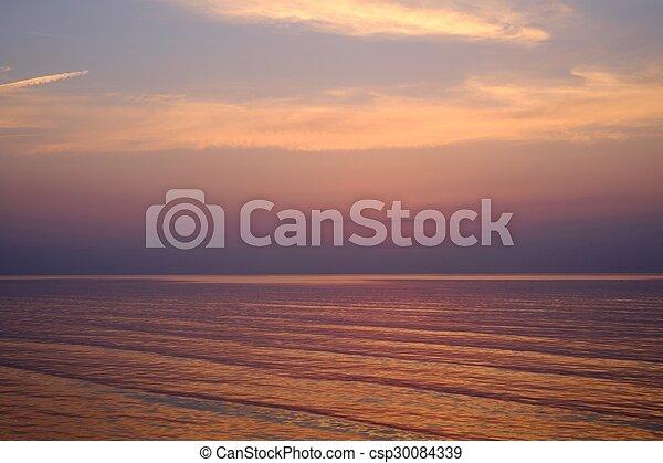 Beautiful sunset over an ocean - csp30084339