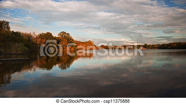 Beautiful sunset over Autumn Fall lake with crystal clear reflec - csp11375888
