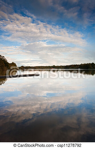 Beautiful sunset over Autumn Fall lake with crystal clear reflec - csp11278792